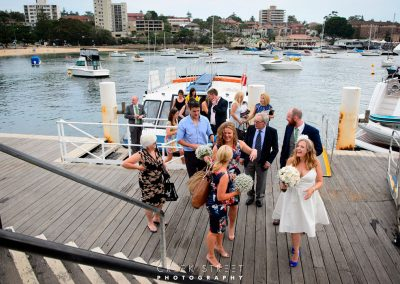 Wedding guests arrive at club house by boat