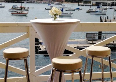 Balcony-Bar table with white sock & view of Manly Cove