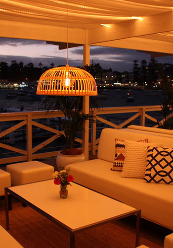 Manly-Yacht-CLub-Balcony-with-sofa-at-night