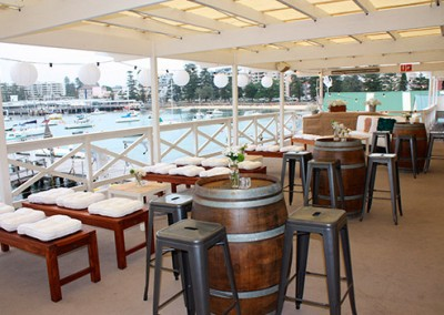 Manly-Yacht-Club-Balcony-Barrels-&-benches