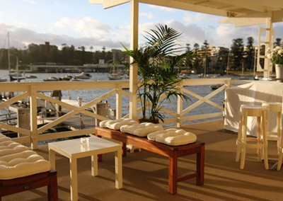 Manly-Yacht-Club-Balcony-benches-&-palms