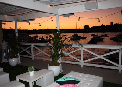 Manly-Yacht-Club-Balcony-view-at-twilight-with-plants