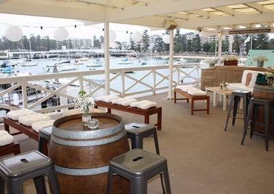 Manly-Yacht-Club-Wine-barrels-on-MYC-balcony-2