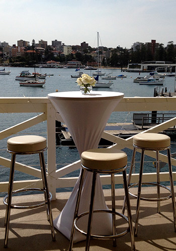 Manly-Yacht-Club-balcony-bar-table-with-white-sock-&-view-of-Manly-Cove