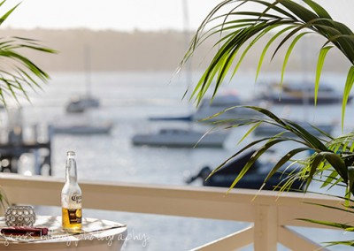 Manly-Yacht-Club-balcony-beer-shot-with-view-of-Manly-Cove