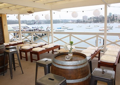 Manly-Yacht-Club-balcony-benches-Wine-barrels-