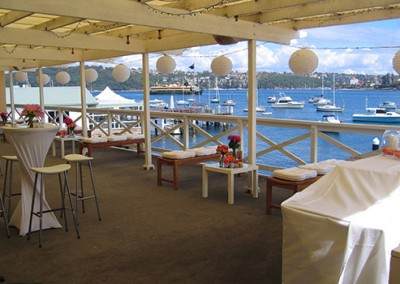 Manly-Yacht-Club-balcony-decorated-with-benches-&-white-theme