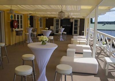 Manly-Yacht-Club-balcony-ottoman-&-bar-tables-theme