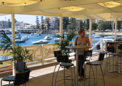 Manly-Yacht-Club-balcony-with-bar-tables