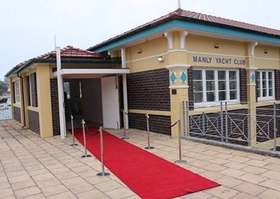 Manly-Yacht-Club-building-entrance-with-red-carpet-
