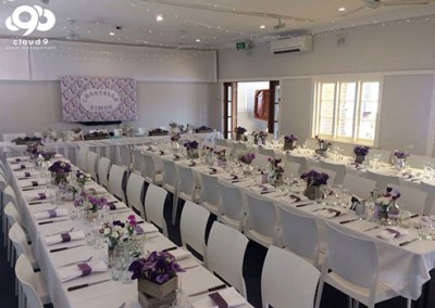 Manly-Yacht-Club-hall-long-tables-purple-theme
